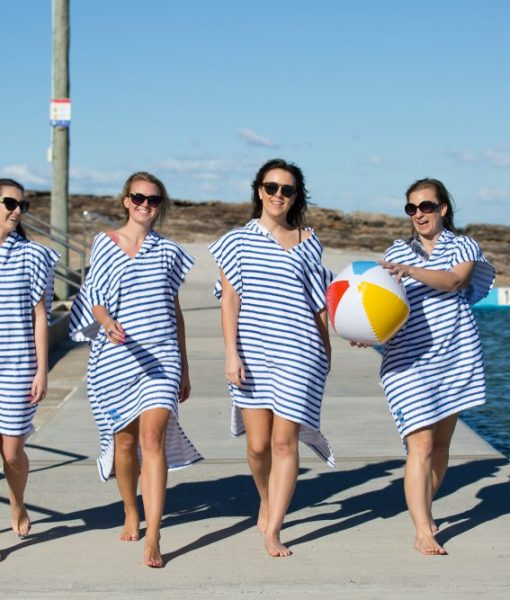 4 girls in blue and white striped poncho towels