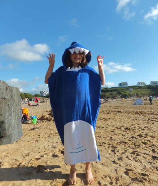 Shark poncho towel on Cornwall beach